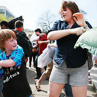 Participants take part in International Pillow Fight Day in Dupont Circle in Washington, DC on Saturday, April 3, 2010.