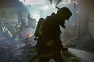 "Firefighters from Engine 106 of the American River fire department gain control of an apartment fire Wednesday, August 23, 2000.  Despite the inherent dangers in firefighting there are far more applicants for jobs than there are openings.  The men in Engine 106 believe that is for several reasons: working hours (10 days a month.24 hour days), good pay, the camaraderie of their fellow workers and the belief by those they serve that they are doing great work.  ""We're heroes when we show up on a fire scene,"" is a common sentiment.  Sacramento Bee/Jay Mather..The Sacramento Bee"