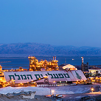 Israel, Sdom, Glowing lights of Dead Sea Works, an Israeli Chemicals potash and salt plant on the Dead Sea