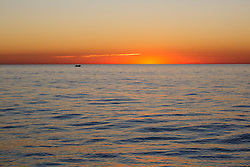 Fishing at sunset off Cable Beach, Broome.