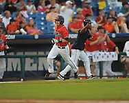 Ole Miss' Kevin Mort (6) scores vs. Auburn during the Southeastern Conference tournament at Regions Park in Hoover, Ala. on Friday, May 28, 2010.  (AP Photo/Oxford Eagle, Bruce Newman)