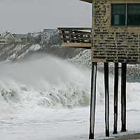 Waves break in front of a house on stilts at Peggotty Beach in Scituate, Massachusetts at the tail end of an overnight blizzard on December 27, 2010.  Parts of Massachusetts received over a foot and a half of snow from the storm and left many homes without power.   UPI/Matthew Healey