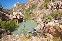 Tourists leave a remote waterfall and swimming pool in Dugong Bay on the Kimberley coast.