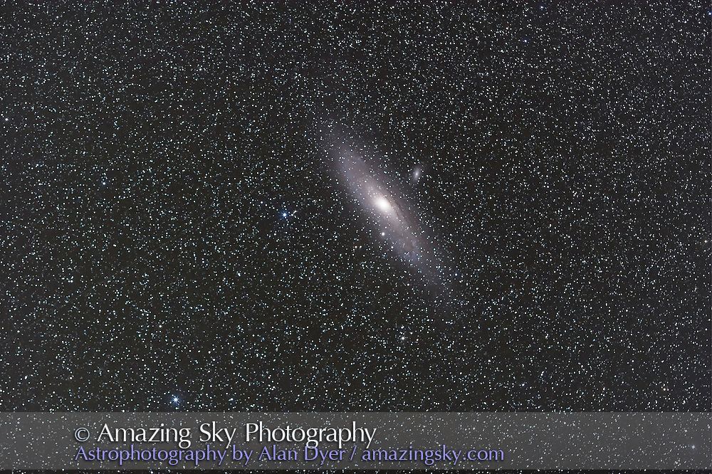 M31, with 135mm Canon L-lens at f/2.8 and Canon 20Da camera at ISO 800 for stack of 3 x 4 minute exposures. Taken Sept. 8, 2007 from home. Very slightly soft. Simulated binocular field.