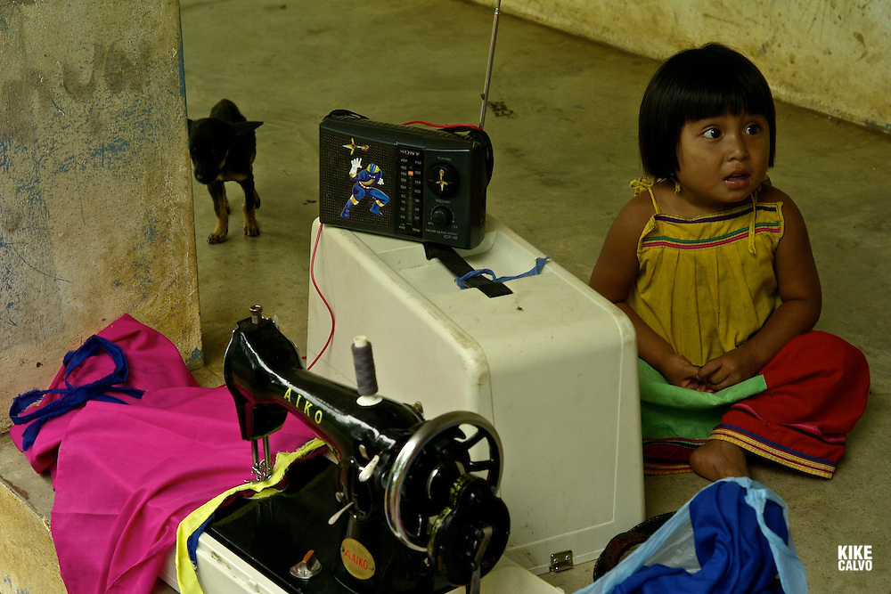 Indigenous old woman sewing a traditional nahua. Chiriqui. Panama.