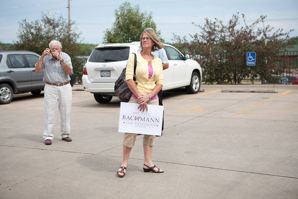 People wait in the parking lot for Republican presidential hopeful Michele Bachmann after a campaign stop on Sunday, July 24, 2011 in Muscatine, IA.