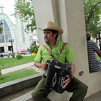 A musician sits in a plaza in Matamoros, Mexico on April 23, 2010. Matamoros has long been controlled by drug cartels and of late the city has been besieged by violence between cartels vying for control of the lucrative drug trade. (Photo/Scott Dalton)