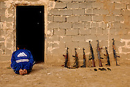 An Iraqi man waits to be questioned for having weapons that are not registered by the Iraqi Police during an Iraqi Police led search of the village by the Emergency Services Unit of Qarah Cham village, Iraq, Mar., 27, 2007. Soldiers are assigned to Headquarters Headquarters Company Headquarters Platoon, 2nd Battalion, 27th Infantry Regiment, 3rd Brigade Combat Team, 25th Infantry Division, Schofield Barracks, Hawaii.