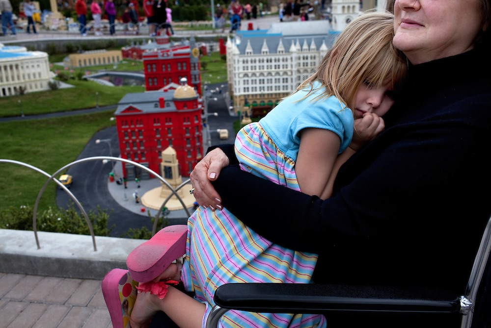 Armanda (sp) Airth, 5, cuddles against her grandmother Janet Airth from Lakeland, Florida, during a cold spell in Miniland, Legoland in Whitehaven, Florida on February 11, 2012.