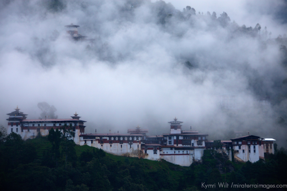 Asia, Bhutan, Trongsa. Trongsa Dzong in clouds, view from Yankhill Resort.