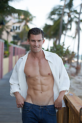 All American man with an open white shirt exposing his muscular toned body