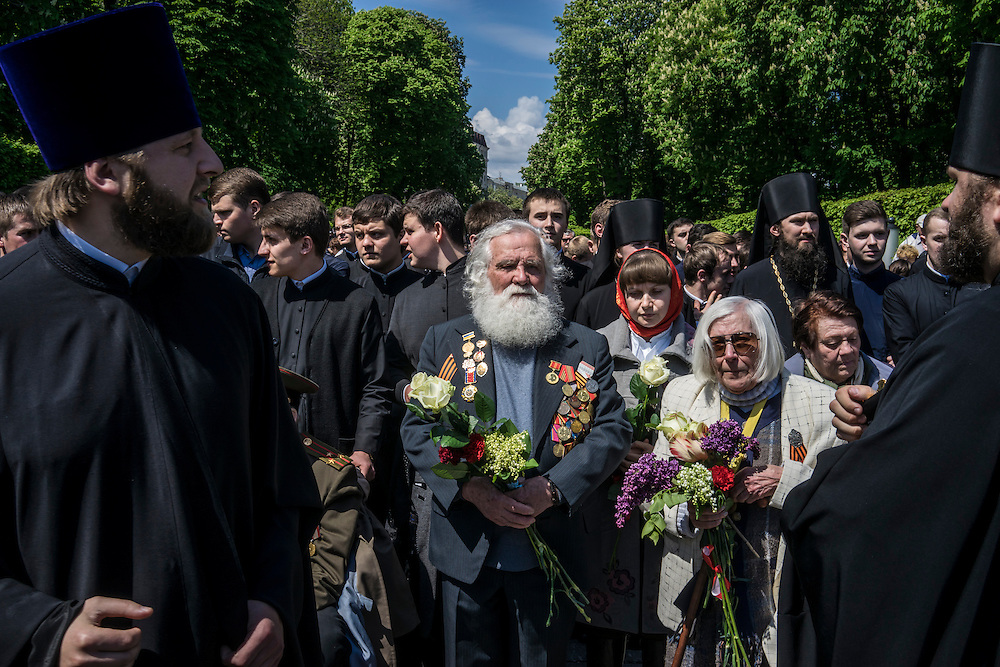Veterans are honored in an Orthodox religious procession during Victory Day commemorations on Saturday, May 9, 2015 in Kyiv, Ukraine.