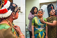 Lincroft, New Jersey, 9/20/14: Hema Ramaswamy, a young Indian American woman with Down syndrome, prepares backstage for her arangetram, the public performance of bharata natyam, a traditional South Indian dance form. She studied with Chitra Venkateswaran (right) in preparation for this recital for four and a half years.