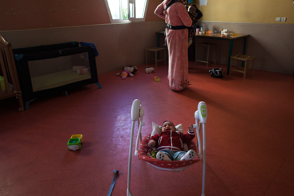 "Casablanca, March 2015. The nursery of the NGO ""Solidarité Feminine"". I., 18 years old , end of the day , after work she returns home with her baby."