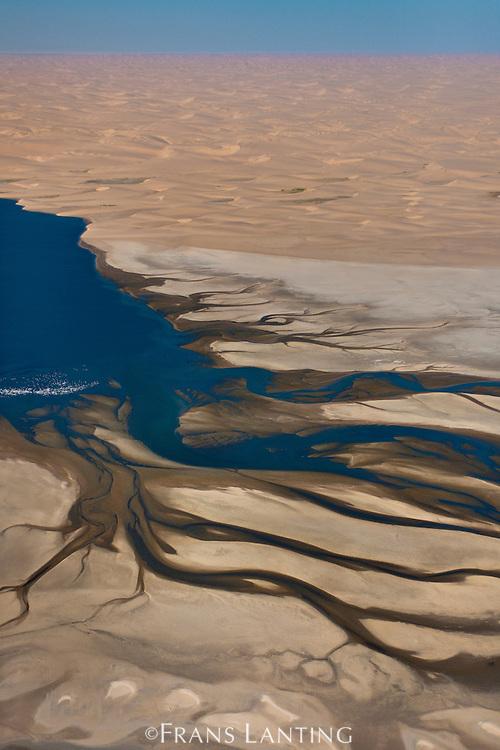 Coastal lagoon and sand dunes, Sandwich Harbour, (aerial), Namib-Naukluft National Park, Namibia