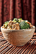 Chicken and broccoli in a bowl with rice.
