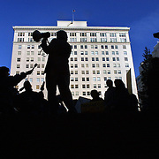 November 26, 2002 - Latino residents and other community members protest at Pioneer Courthouse Square for the resignation of Police Chief Mark Kroeker. They are upset about the awarding of medals to the officers who shot and killed Jose Mejia Poot.