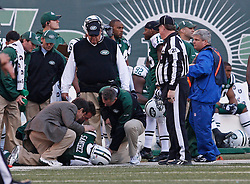 Nov 29, 2009; East Rutherford, NJ, USA; New York Jets quarterback Mark Sanchez (6) rolls his ankle while being tackled by Carolina Panthers cornerback Richard Marshall (31) during the second half at Giants Stadium. Sanchez left the game, but returned on the Jets next possession.  The Jets defeated the Panthers 17-6.