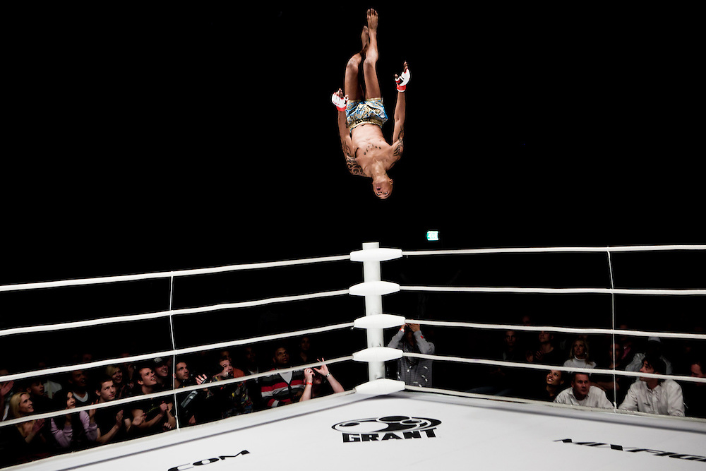 """Viktor """"Tigri"""" Kuku is doing a backward flip following his victory at the M-1 selection tournament Western Europe."""