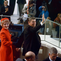 Nancy and newly-sworn-in President Ronald Reagan wave from the podium at the 1981 Presidential Inauguration.