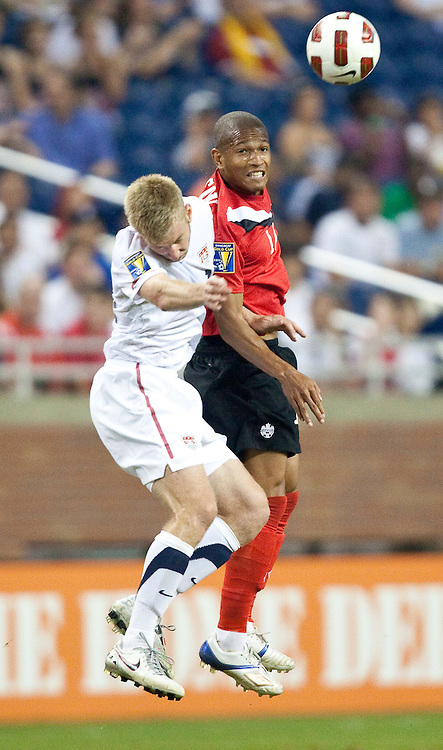 GR8007 -20110607- Detroit, Michigan,USA<br /> Tim Ream of the United States and Canada's Terrence Dunfield attemt to head the ball during their CONCACAF match at Ford Field in Detroit Michigan, June 7, 2011.<br /> AFP PHOTO/Geoff Robins