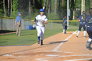 Oxford High's Madison Crosby scores vs. Pearl in MHSAA Class 5A playoff action in Oxford, Miss. on Friday, April 25, 2014.