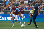 Nathan Delfouneso chase down a ball held by Amobi Okugo of the Philadelphia Union during a match between Aston Villa FC and Philadelphia Union at PPL Park in Chester, Pennsylvania, USA on Wednesday July 18, 2012. (photo - Mat Boyle)