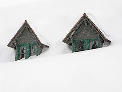 two gables of the snowed-in Paradise Inn at Mount Rainier National Park, Washington, USA