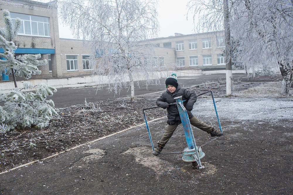 A child plays on the school playground on Saturday, December 12, 2015 in Zolote, Ukraine.