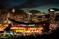 A night shot of the Calgary Saddledome with the city skyline in the background. ..©2008, Sean Phillips.http://www.Sean-Phillips.com