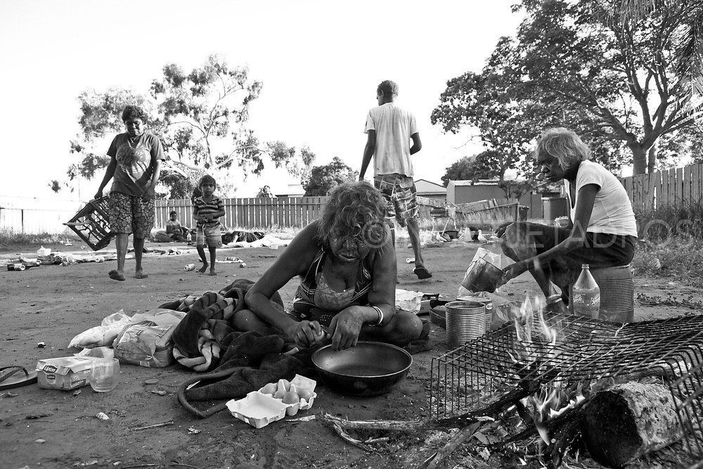 Eggi cooks breakfast while Loraine helps her. They are<br />
