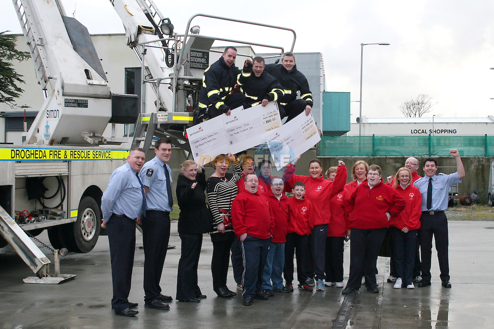 Drogheda Fire and Rescue raises EUR25,500 for three local charities, Drogheda Special Olympics, Drogheda Womens Refuge and Drogheda Community Services Centre through the sale of their Calendar.  Roisín O'Rourke recieves a cheque for EUR8,500 on behalf of Drogheda Community Services Centre, Carrie Cowan on behalf of Drogheda Womens Refuge and Jane Coyle on behalf of Drogheda Special Olympics...Photo NEWSFILE/Jenny Matthews.(Photo credit should read Jenny Matthews/NEWSFILE)....This Picture has been sent you under the condtions enclosed by:.Newsfile Ltd..The Studio,.Millmount Abbey,.Drogheda,.Co Meath..Ireland..Tel: +353(0)41-9871240.Fax: +353(0)41-9871260.GSM: +353(0)86-2500958.email: pictures@newsfile.ie.www.newsfile.ie.FTP: 193.120.102.198.