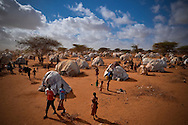 Temporary homes are pouring into the overflow area of the Ifo Extension camp in Dadaab, Kenya.  Dadaab is the largest refugee camp in the world, the United Nations reports that nearly 400,000 people reside in the camp. It was originally built to capacitate only 90,000.