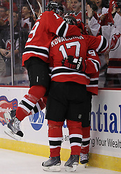 Oct 8; Newark, NJ, USA; New Jersey Devils left wing Ilya Kovalchuk (17) and New Jersey Devils left winger Zach Parise (9) celebrate Parise's goal during the first period of their game against the Dallas Stars at the Prudential Center.