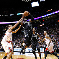 29 January 2012: Miami Heat shooting guard Dwyane Wade (3) is fouled by Chicago Bulls center Joakim Noah (13) during the Miami Heat 97-93 victory over the Chicago Bulls at the AmericanAirlines Arena, Miami, Florida, USA.
