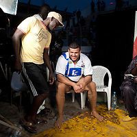 02/07/2012. Senegal, Dakar. One day with the White Lion.    The canarian wrestler Juan Espino, the unique white fighter in the senegalese wrestling. The White Lion agrees to do a live interview on TV just after his victory .   ©Sylvain Cherkaoui