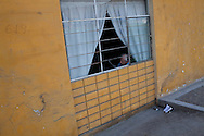 A man reads in a window on Saturday, Apr. 18, 2009 in Ventanilla, Peru.