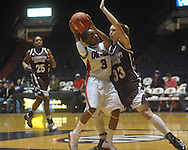 "Ole Miss' Valencia McFarland (3) drives against Mississippi State's Mary Kathryn Govero (33) in a NCAA women's college basketball game at the C.M. ""Tad"" Smith in Oxford, Miss. on Thursday, February 10, 2011.  Mississippi State won 59-43.."