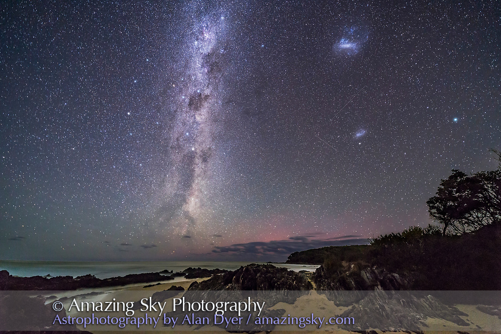 The wonders of the southern hemisphere sky rising over the Tasman Sea at Cape Conran, on the Gippsland Coast of Victoria. Australia, on March 31, 2017. <br /> <br /> The head and neck of the Dark Emu is rising from the ocean. At top is the Carina Nebula area, below is Crux, the Southern Cross, and below it are the twin Pointer Stars of Alpha and Beta Centauri. At top right is the Large Magellanic Cloud, and below it is the Small Magellanic Cloud. Left (north) of the Crux and Pointers is the fuzzy spot of Omega Centauri globular cluster. At far right is the star Achernar. At centre is the area of the South Celestial Pole. <br /> <br /> The dim red glow in the sky due south at centre might be aurora australis but is likely airglow.<br /> <br /> This is a stack of 4 x 40-second exposures, untracked, for the ground, mean combined to smooth noise, and one 40-second exposure for the sky, all at f/2.5 with the 14mm Rokinon lens and Canon 6D at ISO 3200.