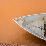 The contaminated waters of Rio Doce in the docks of Regencia