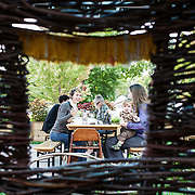 Guests, as seen through a window in a Thicket made by Kelly English of Cherriup, enjoy brunch at Tiny Diner in Minneapolis, MN.
