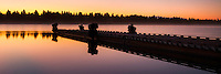 Panoramic sunrise on a warm Summer morning on Hebgen Lake in Southwestern Montana.