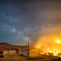 A structure threatened by the Erskine Fire near Lake Isabella CA, as flames move uphill.<br /> <br /> The Erskine Fire burns near Lake Isabella and Kernville, CA USA in Kern County, CA. By Friday afternoon the fire had burned over 19,000 acres, destroyed an estimated 100 homes, and caused two fatalities. The blaze was 0% contained. <br /> <br /> Long exposure image