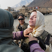 A translator (Sahar ) prepares women with the 2-27's Female Engagement Team (FET) for a water filtration demonstration in the village of Nari, Kunar Province of Eastern Afghanistan with Waves For Water and the US Military.