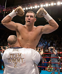 June 10, 2006 - New York, NY - Notre Dame defensive back, Tommy Zbikowski celebrates his first round KO over Robert Bell at Madison Square Garden.  It was Zbikowski's pro debut.