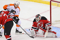 Jan 22, 2013; Newark, NJ, USA; New Jersey Devils goalie Martin Brodeur (30) makes a save on Philadelphia Flyers left wing Ruslan Fedotenko (26) during the first period at the Prudential Center.