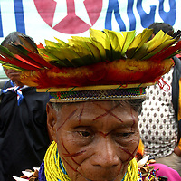 A Secoya Indian elder attends a protest against Texaco outside of the court house in Lago Agrio, in northern Ecuador, on Tuesday October 21, 2003. Residents of Lago Agrio and neighboring towns, including many indigenous communities, claim that the U.S. oil company Texaco is responsible for contaminating the region during their years of operating the oil fields in the region. They are arguing in court that the contamination caused environmental damage and numerous cases of cancer and other illnesses throughout the area. (Photo/Scott Dalton)