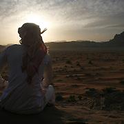 A Bedouin man lokks at the sunset in Wadi Rum Jordan, may 14, 2013. Photo by Oren Nahshon
