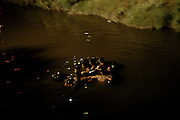 Illegal aliens float into the U.S. in the heavily polluted New River in Calexico, Calif. on Monday, March 28, 2005, just yards from the U.S./Mexico border. Mexicans use the polluted river and darkness to shield them from the U.S. Border Patrol.<br />