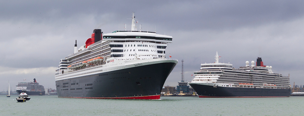 Cunard Line's three queens, Queen Mary 2(centre), Queen Elizabeth (right) and Queen Victoria (left) depart Southampton in formation as part of the historic shipping lines' 175th anniversary celebrations. <br /> Picture date Sunday 3rd May, 2015.<br /> Picture by Christopher Ison. Contact +447544 044177 chris@christopherison.com